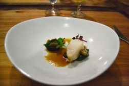 Roasted Sablefish spinach puree with fresh New Zealand leaves. hazelnut. blow torched beef marrow. beef jus.