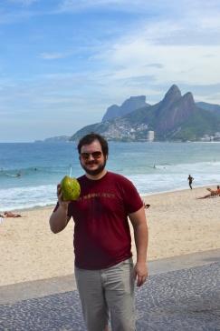 Hew enjoying a coconut beverage